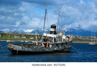 Old boat in harbor of Ushuaia, Argentina