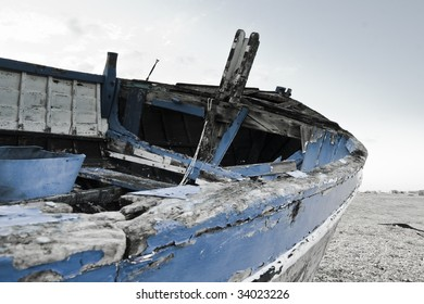 Old boat laying on land