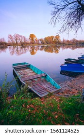 Old boat on the autumn pond in Tisza, Hungary