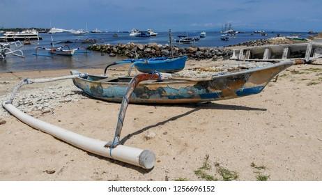 Old fisherman's boat on the beach in Sammer Harbour in Bali