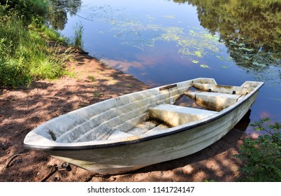 Old boat on the river shore