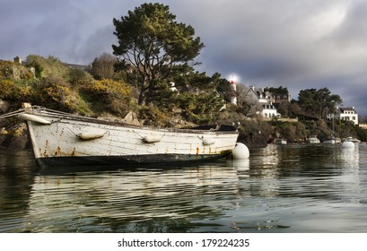 Old boat in the port in france one stormy day