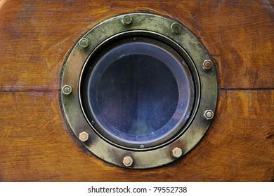Old boat porthole close-up