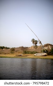 An old boat and and a sailboat next to the Nile