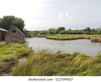 Old boathouse next to the river.