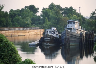 Old boats deteriorating at dock