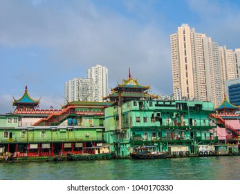 Old boats and high-rise apartments in Hong Kong