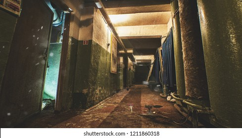 the old bomb shelter, with the lights on, and the hermetic door. Asylum from war and nuclear explosion, Long bomb shelter corridor, with tanks for water and room for sheltered