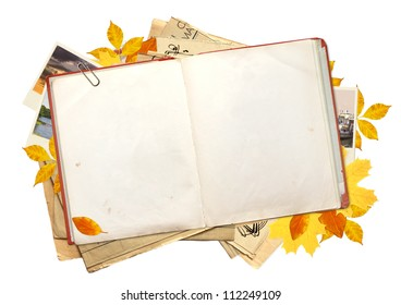 Old book, autumn leaves and photos. Objects isolated over white