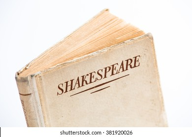 An old book by Shakespeare on white background