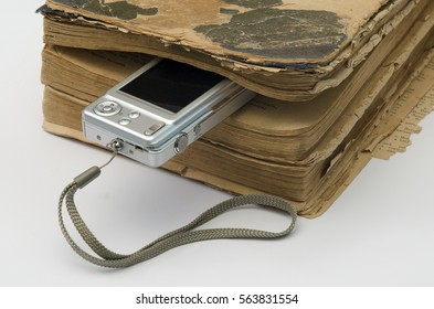 old book and a digital camera as a bookmark