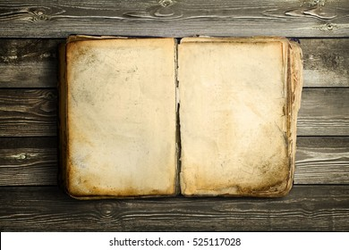 Old book with empty sheets and over wood background