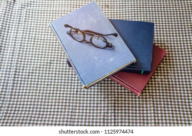 old book with eye glasses