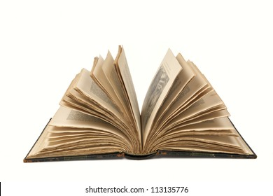 Old book fanned open, isolated on white.  Clipping path included.