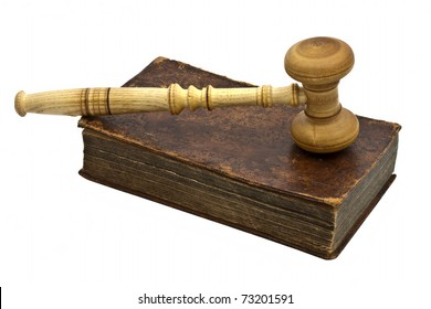 Old book and gavel isolated on white background