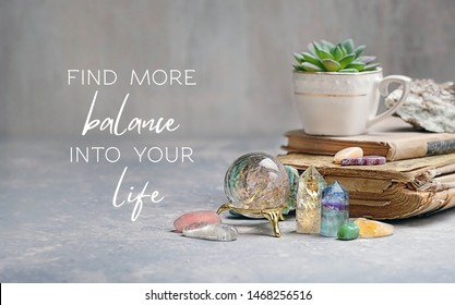 old book, home plant and gemstones minerals for relaxation, meditation. magic Rock crystal, fluorite, citrine, charoite, rose quartz. find more balance into your life - motivation quote.