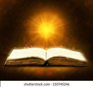 Old book with magic Ray of light