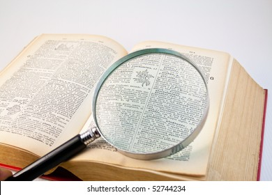 Old book with a magnifier lens