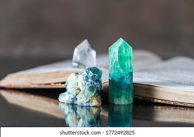 Old book and mineral stones crystals. Crystal Ritual, Healing Crystals. Natural gemstones. Gemstones are full of healing energy and good vibes. Selective focus, copy space.