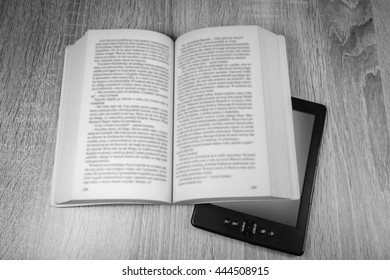Old book and modern one, black and white photo