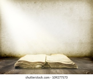Old book on wood with Ray of light background