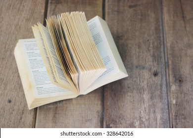 The old book was opened on wooden background, Still Life