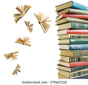Old book pile and open books flying away isolated on white background
