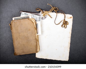 old book, rusty key and empty photograph as a memory metaphor