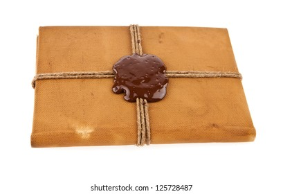 old book with seal wax isolated on white