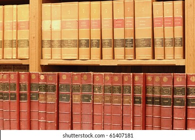 old books of the 19th century of paris on a shelf in a library