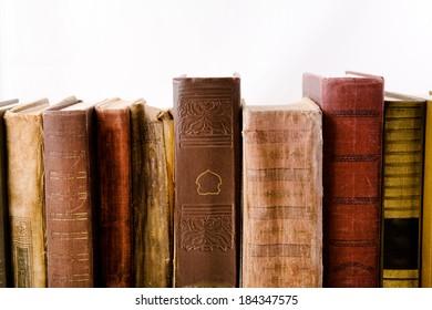 Old books backs on white