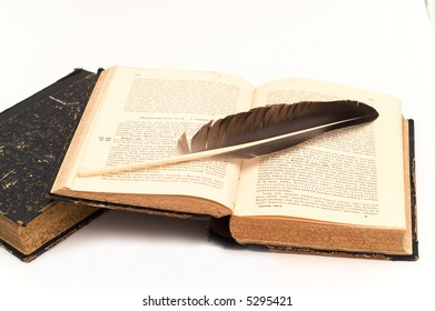 old books with the black feather