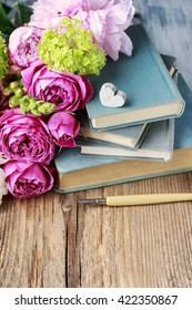 Old books and bouquet of flowers