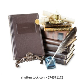 Old books, burning candle in candlestick, feather pen in inkpot,  bookrest and scroll with stamp, isolated on white background