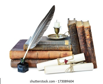 Old books, candle in candlestick, feather in inkpot and scroll with stamp