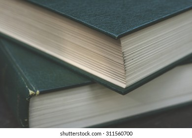 old books close up with green leather cover