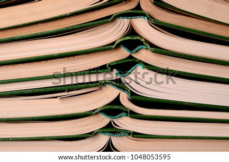 Old books, with a green cover, yellowed pages