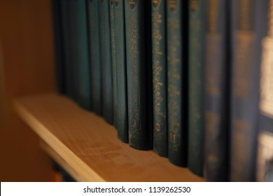 Old books with large gold numbers on the shelf. Retro style with stripes.