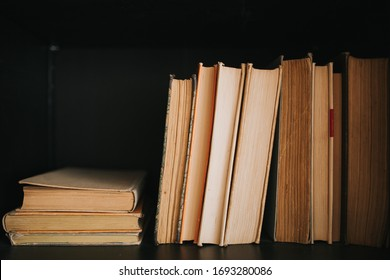 old books on the black shelf
