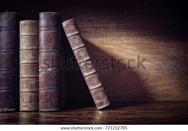 Old books on a library or bookshop shelf background with copy space