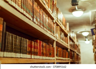 Old Books On A Shelf In The Library
