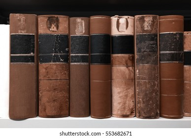 old books on shelves in public library