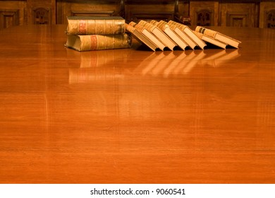Old books on shining table