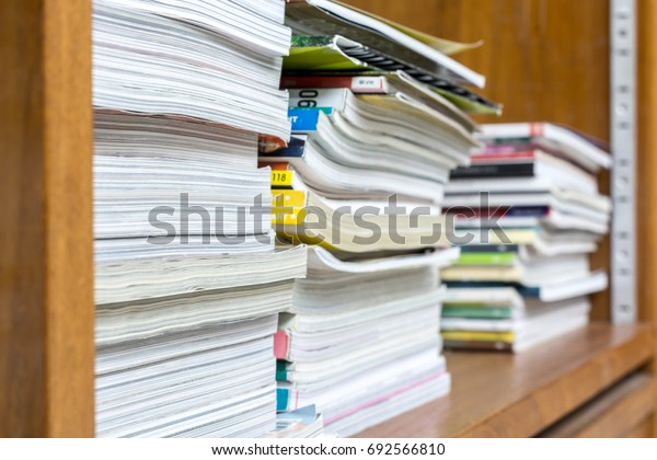 old books on wood shelf