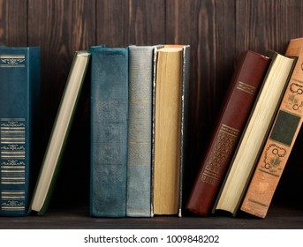 Old books on wooden background. The source of information. Books indoor. Home library. Knowledge is power