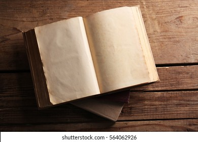 Old books on wooden background, top view