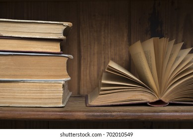 Old books on a wooden bookshelf
