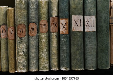 Old books with Roman numerals in the library