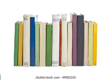 Old books in a row, all hardbacks some with leather covers