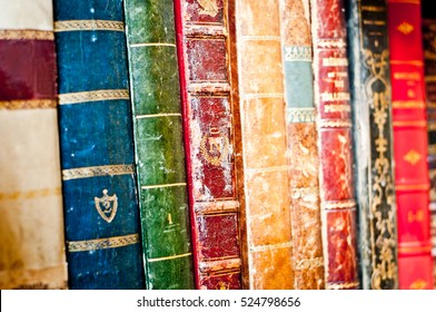 Old books row background. Antique manuscripts.
